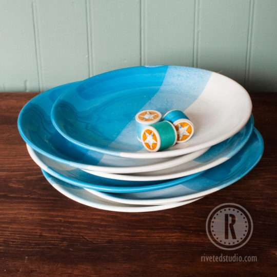 stack of blue handmade plates