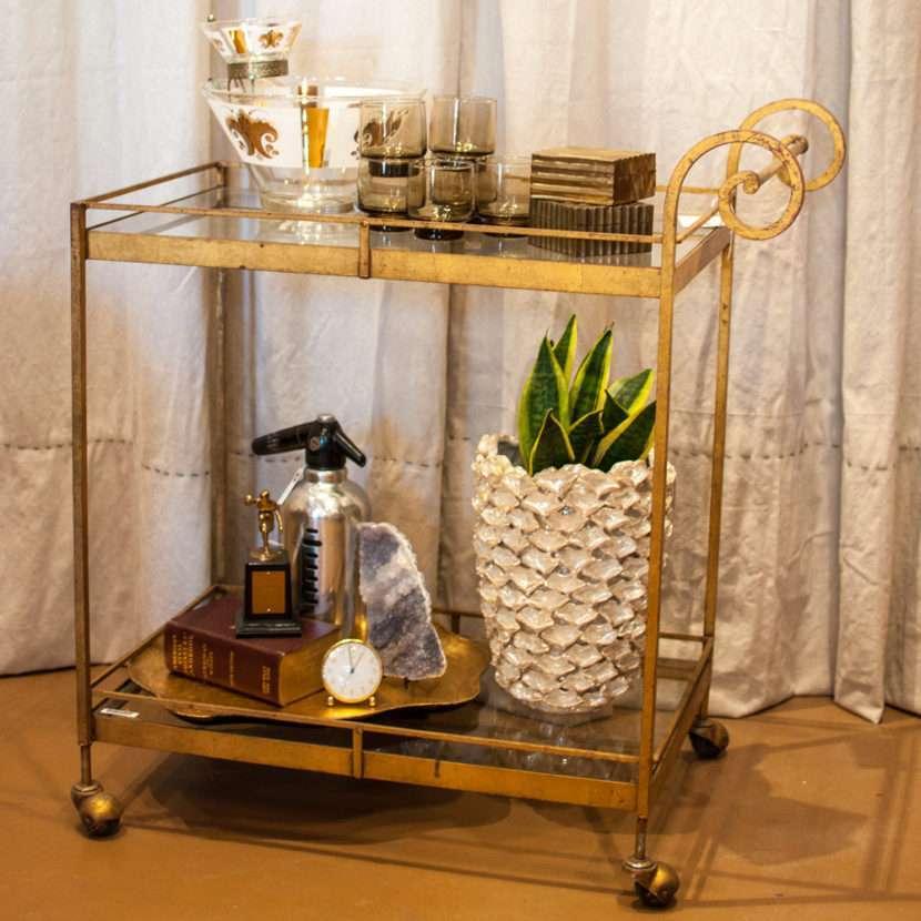Gold wrought iron bar cart